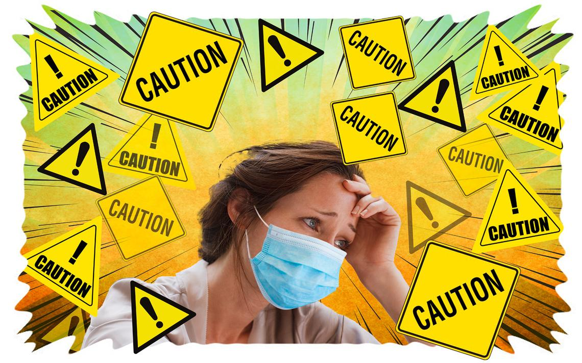 Person with a mask surrounded by Caution signs