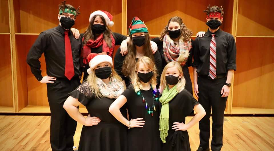 Covid Christmas singers, all wearing masks