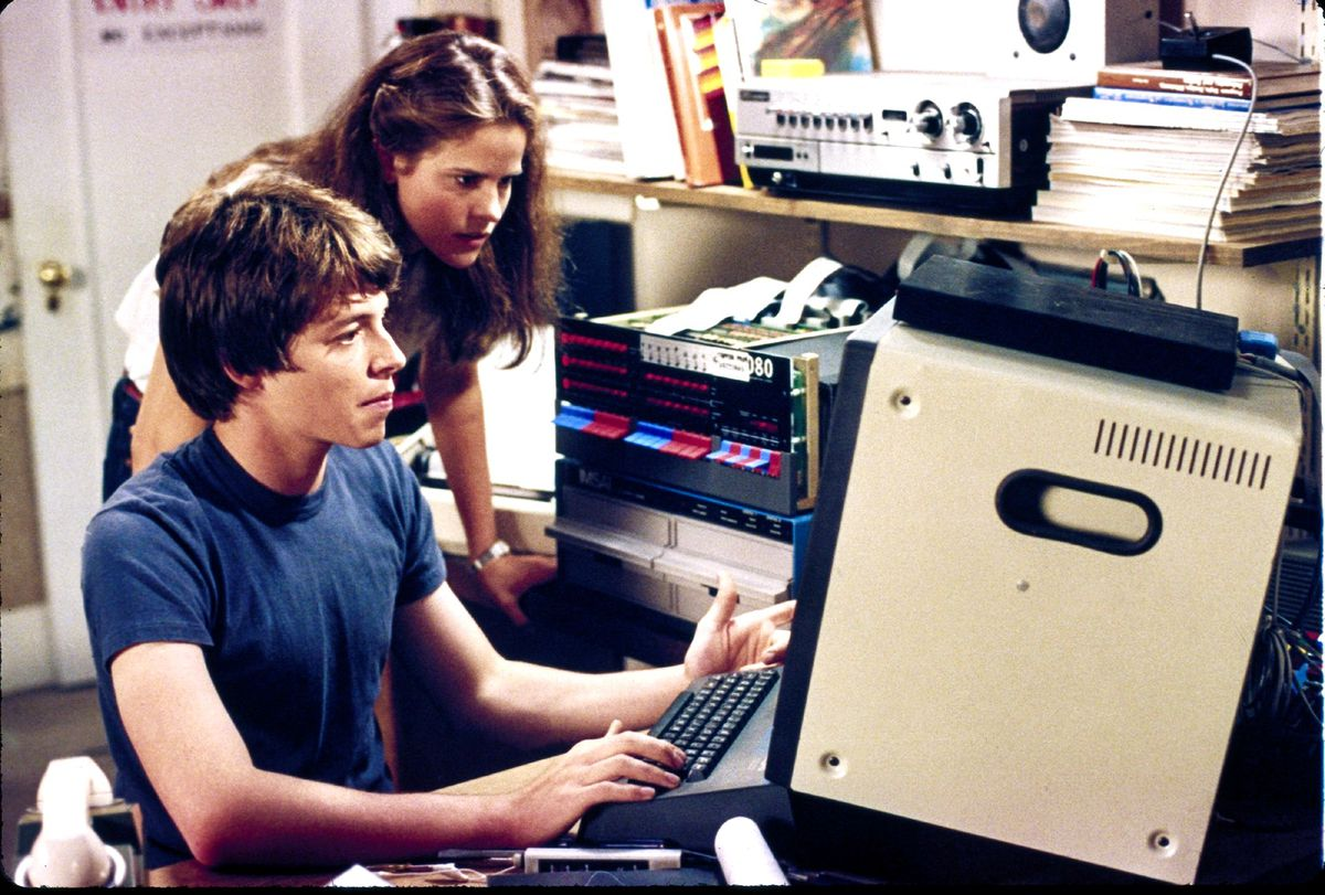 Still shot from movie War Games with Matthew Broderick and Ally Sheedy sitting in front of a computer